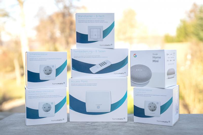Homematic IP Starter Set + Smart Home Schalten (Homematic IP Access Point, 2 x Homematic IP Schaltsteckdosen, Homematic IP Schalt-Mess-Steckdose, 1 x Homematic IP Wandtaster 6-fach, Homematic IP Fernbedienung) + Google Home Mini